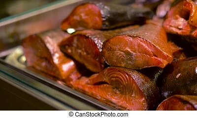 smoked fish on tray - food sale, small business and seafood...