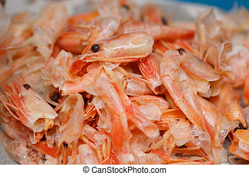 Food scraps from Shrimp peeled on the plastic plate, recycle...