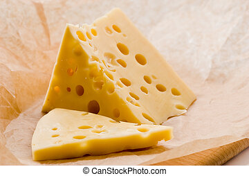 piece of cheese - food series: piece of cheese on the paper