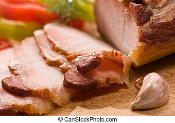 ham - food series: sliced ham on the wooden board