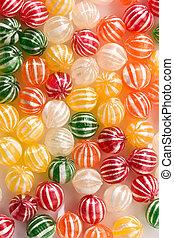 sugar candy - food series: sweet background of striped sugar...
