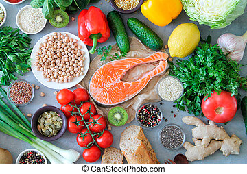 Food sources of omega 3, protein and healthy fats on light stone background top view