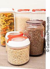 Food storage - raw food ingredients inside transparent jars close up