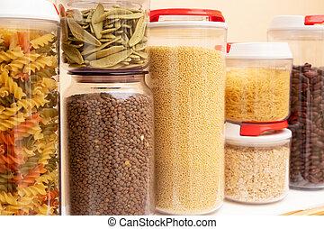 Food storage - raw food ingredients inside transparent jars, close up view