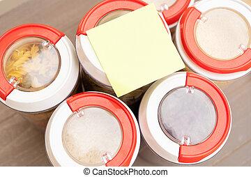 Food storage - raw food ingredients inside transparent jars, top view
