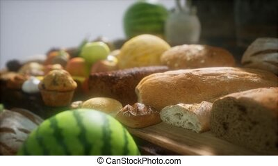 food table with wine barrels and some fruits, vegetables and bread