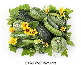 food top view basket of zucchini with flowers and leafs isolated on white background