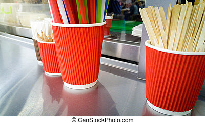 Food truck counter with straws, cups and spoons - Closeup...