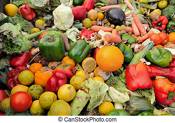 Rotten fruit and vegetable waste in a dumpster
