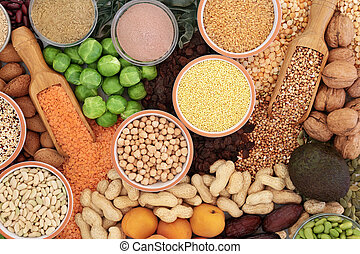 Food with high protein content with vegetables, legumes, dried fruit, nuts, seeds, grains and supplement powders. Foods high in dietary fibre, antioxidants and vitamins. Top view.