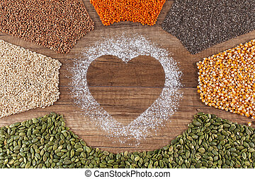 Food with love concept with various seeds and grains