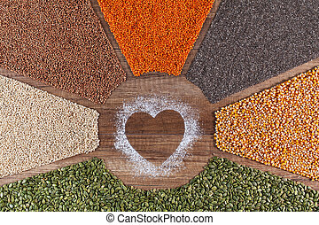Food with love - plant based diversified diet concept with colorful grains and seeds