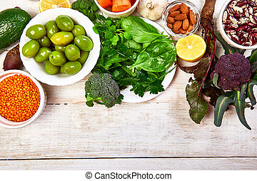Foods for healthy liver on white wooden background.