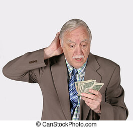 senior mature man with money looking confused