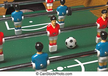 Foosball Game - A miniature tabletop foosball arcade type...