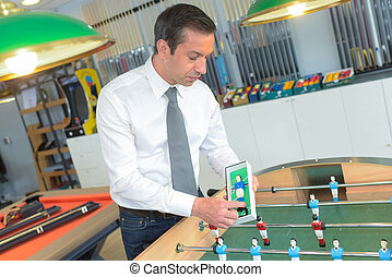 foosball, mostrando, produto, vendedor
