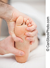 Foot being held by two hands