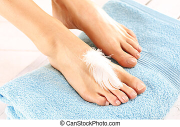 Foot Care - Foot care treatment and nail, the woman at the...