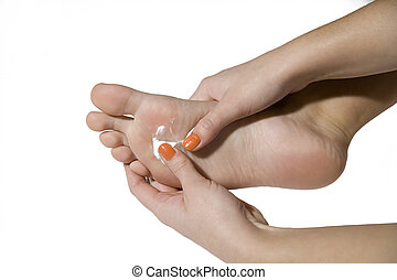 foot care with hands and cream on the white background