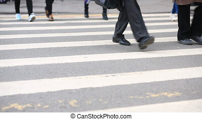 foot crosswalk. People cross the road. feet walking on the pavement.
