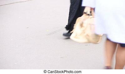 foot crosswalk. People cross the road. feet walking on the pavement.