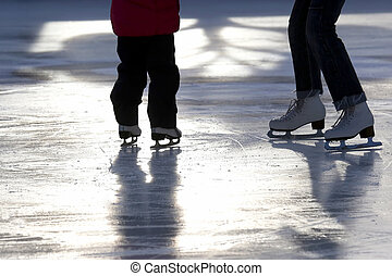 foot ice-skating little girl with my mom at the rink