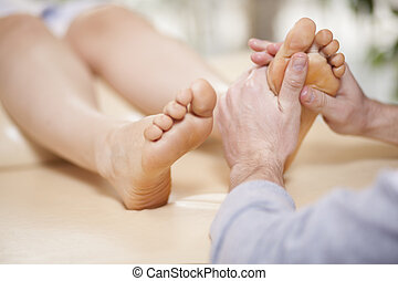 Foot massage at a spa