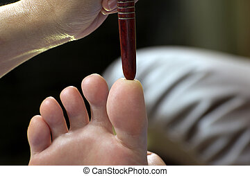 foot massage by wood stick for frontal sinuses