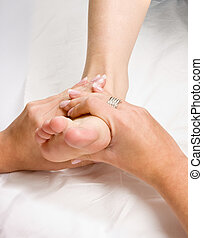 Foot massage - Female hands giving a healthy foot massage