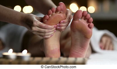 Macro shot of feet massaged by unrecognizable specialist
