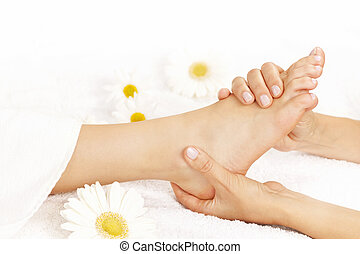 Foot massage - Female hands giving massage to soft bare foot