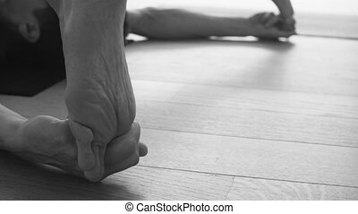 Foot of a man doing yoga asana. - Close up of foot of a man...