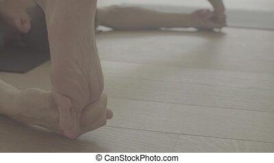Foot of a man doing yoga asana. - Close up of foot of a man...