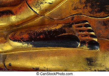 Foot of golden buddha image