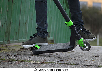 foot of the young man in skateboarding