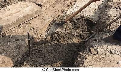 Foot of worker with shovel.