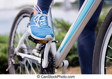 Foot on a bicycle pedal