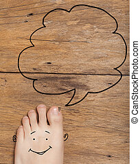 foot on old wood background