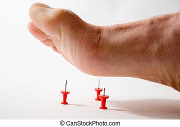 Foot Pain - Foot stepping on tacks