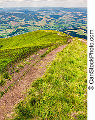 foot path down the grassy hillside. location mountain Gymba,...
