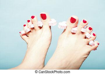 foot pedicure applying red toenails on blue - foot pedicure ...