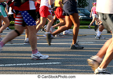 Foot Race - A view of a group of runners from street level