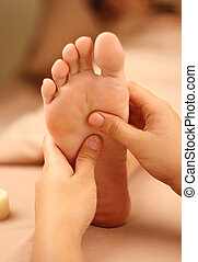 reflexology foot massage, spa foot treatment