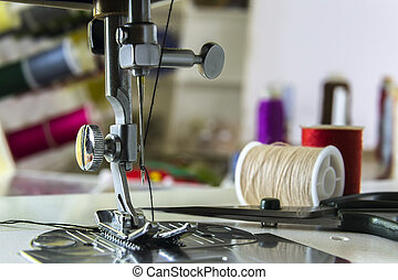 foot sewing machine with thread inserted on the needle -...