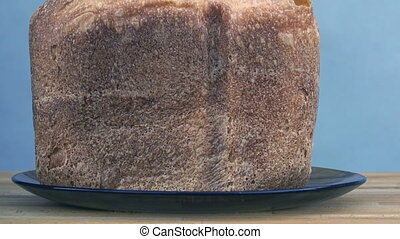 loaf of bread in a plate on the table