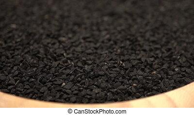 black cumin or caraway heap rotating - Footage black cumin...