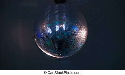footage disco ball rotation on the ceiling in night club