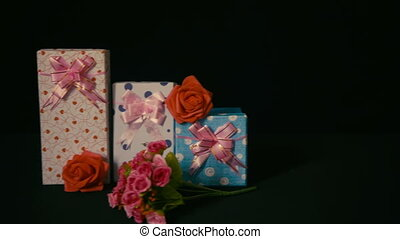 Footage greeting valentine of gift boxes with flower rose...