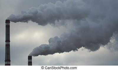 Footage industrial chimneys emits toxic pollutants into the sky polluting the environment. 4K