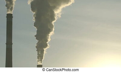 Footage industrial chimneys emits toxic pollutants into the sky polluting the environment